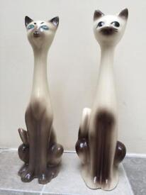 Two cat ornaments