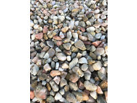 Finished Pink / white decorative gravel for driveways or paths.