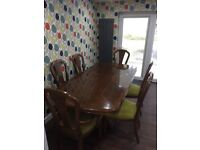 Beautiful dining table and chairs has an extending leaf can sit 8 people comfortably .