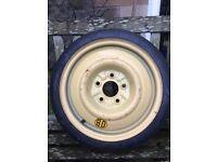 "Space saver tyre, 15"", unused"