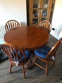 Solid wood extending dining room table and four chairs