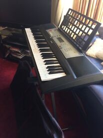 Yamaha keyboard with case and stand