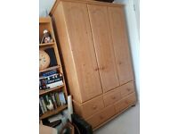 Large Pine wardrobe with 3 doors and five drawers on ball feet with etched floral motif