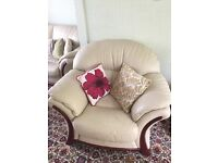 3 piece beige leather sofa suite and footstall