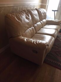 Pale cream leather sofa with double recliners