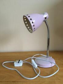 Flexible lamp with pink metal and attractive cut out heart detail on lamp shade.