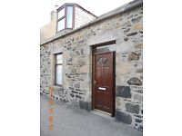 Mid Terraced One and a Half Storey Property in Banff, close to the town centre and marina area