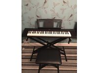Yamaha keyboard with stand and seat
