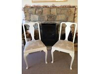 Two newly painted and reupholstered dining chairs. Both have sprung seats.