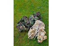 Camouflaged Gore-Tex and Camel Packs