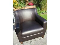 Two Brown Leather Arm Chairs