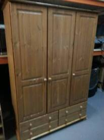 A brand new 3 door 4 drawer pine wardrobe.