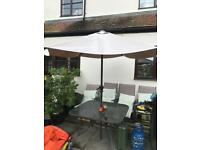 Garden table, parasol and 4 chairs