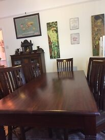 Traditional hardwood 8 seater table and 8 chairs