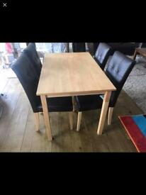 BRAND NEW PRIMO DINING TABLE WITH 4 BRAND NEW CHAIRS