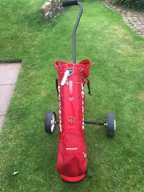Golf bag, trolley, balls and clubs.