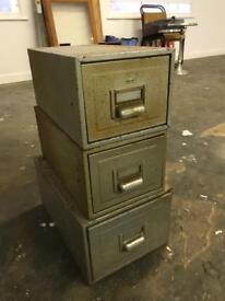 Three metal small cabinets