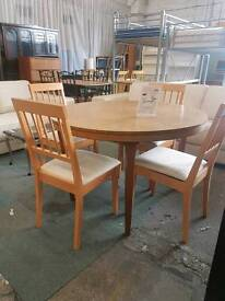 Round extendable table and four chairs set