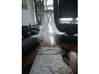 Cot bed canopy with matching bedding