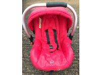 Red Pebble pushchair with carry cot and matching car seat.
