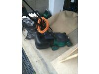Electric lawn mower with grass collection box