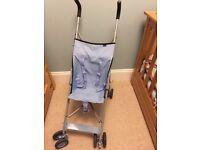 Blue buggy pushchair