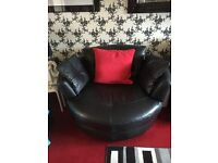 Black leather corner sofa with large swivel chair