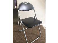 Black padded folding black chair