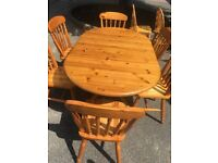 SOLID PINE DROP LEAF TABLE AND 6 CHAIRS VGC APART FROM SOME LIGHT SCRATCHES ON TOP SURFACE