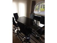 Rectangular black glass dining table with matching sideboard and 6 dining chairs