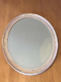 Oval ornate beige/gold punted plaster mirror