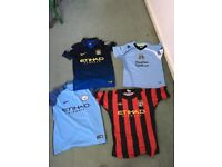 4 x boys Manchester City Shirts