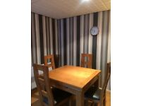 Nearly new high quality dining room table and chairs