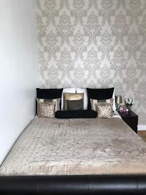 Black/Brown faux leather double bed.