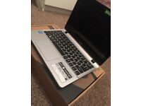 Silver touch screen laptop