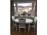 Large extending wooden table and dining chairs set