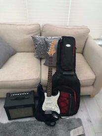 Blue Electric Guitar, Amplifier and Padded Carry Case