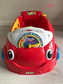 Fisher Price Laugh & Learn sit-in car