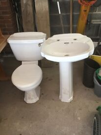 White cottage style wash basin and toilet