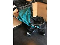 Joie lightweight Green Pram with rain cover