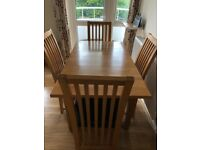 Solid oak table and Four dining chairs