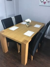 Harvey's solid oak dining table and 4 chairs
