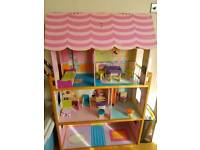 Dolls house/bookcase with wooden furniture