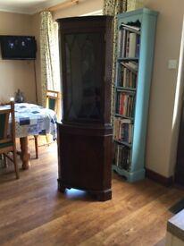 Mahogany corner unit 2 shelves inside glass door and 1 shelf inside wooden door.