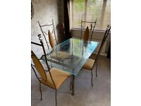 Bespoke glass dining room table and 4 chairs