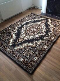 Large black pattern rug 185x270