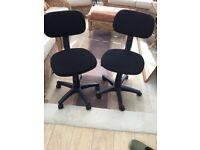 Black office swivel chairs .
