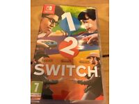 **SEALED** NINTENDO SWITCH AND 1-2 SWITCH GAME BRAND NEW AND INCLUDES 1 YEAR WARRANTY