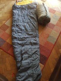 """Two """"caravan"""" brand mummy sleeping bags."""