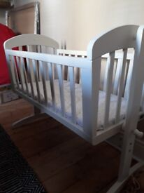 M and P baby swinging crib with unused mattress.